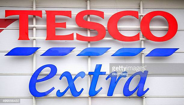 A Tesco Extra sign hangs above the main entrance to the Tesco Basildon Pitsea Extra supermarket operated by Tesco Plc in Basildon UK on Tuesday Dec 1...