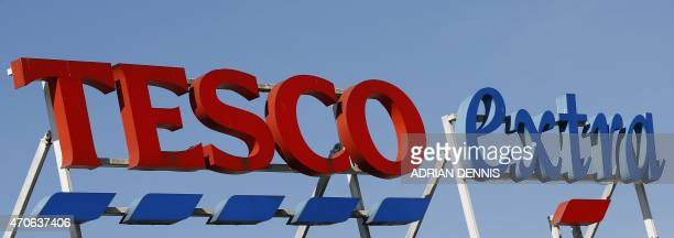 A Tesco logo is pictured at a supermarket in Sunbury west of London on April 22 2015 Britain's biggest retailer supermarket group Tesco announced...