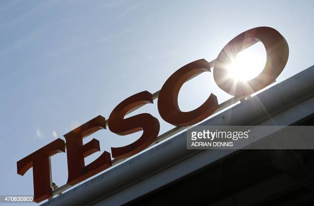 A Tesco logo is pictured at a supermarket in west London on April 22 2015 Britain's biggest retailer supermarket group Tesco announced Wednesday that...