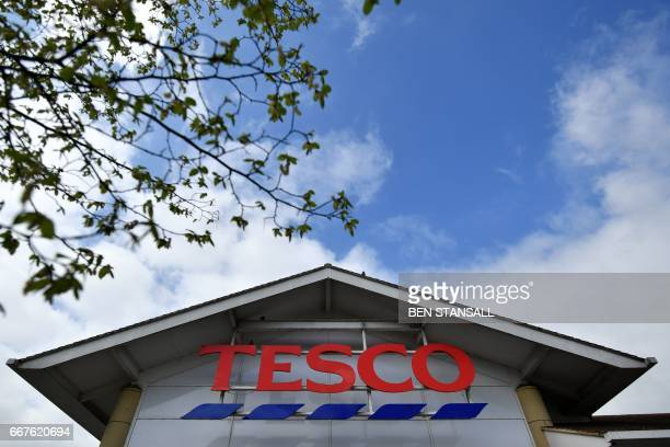 A Tesco logo is pictured outside one of the company's supermarkets in Sevenoaks southeast of London on April 12 2017 Supermarket giant Tesco revealed...