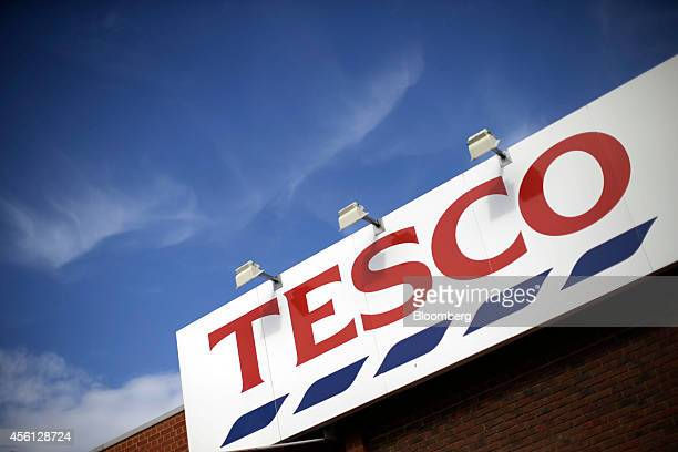 A Tesco logo sits outside a Tesco Extra supermarket store operated by Tesco Plc in the Surrey Quays district of London UK on Thursday Sept 25 2014...