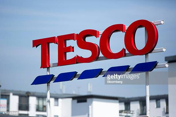 A Tesco logo stands on display outside a Tesco supermarket operated by Tesco Plc in London UK on Monday April 20 2015 Tesco's April 22 results will...