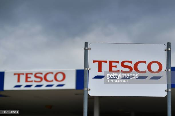 Tesco logos are pictured outside one of the company's supermarkets in Sevenoaks southeast of London on April 12 2017 Supermarket giant Tesco revealed...