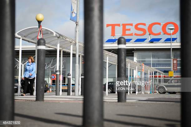 A Tesco supermarket is pictured in north London on August 29 2014 British supermarket giant Tesco on Friday issued another profits warning and...