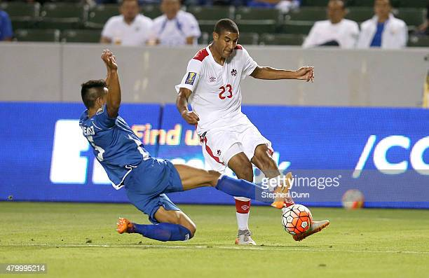 Tesho Akindele of Canada tries to pass the ball past Alexander Mendoza of El Salvador in their CONCACAF Gold Cup Group B match at StubHub Center on...