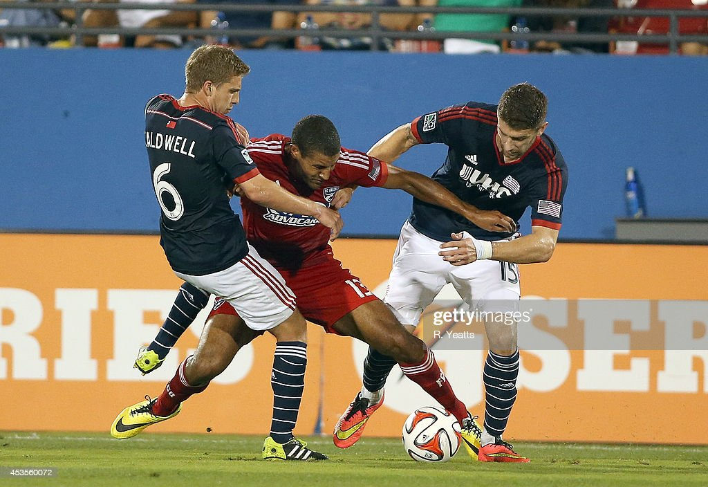 Tesho Akindele #13 of FC Dallas fights to maintain control of the ball against the New England Revolution at Toyota Stadium on July 19, 2014 in Frisco, Texas.