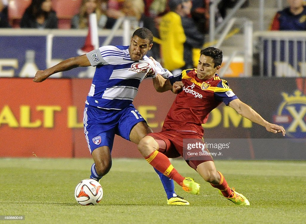 Tesho Akindele of FC Dallas is grabbed by Tony Beltran of Real Salt Lake during second half play at Rio Tinto Stadium May 24 2014 in Sandy Utah The...