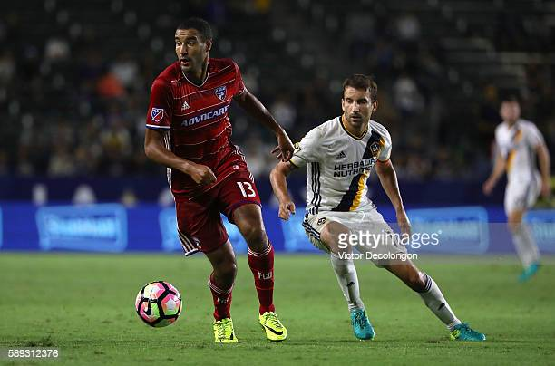 Tesho Akindele of FC Dallas plays the ball away from Mike Magee of the Los Angeles Galaxy during the semifinal of the 2016 US Open Cup at StubHub...