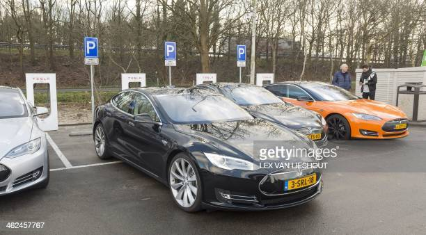 A Tesla cars are pictured during the opening of The Netherlands first Supercharger station for electric cars in Oosterhout on January 13 2014 At...
