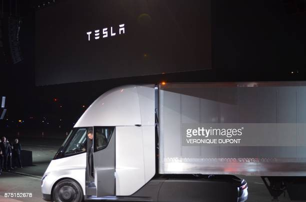 Tesla Chairman and CEO Elon Musk steps out of the new 'Semi' electric Truck during the unveiling for buyers and journalists on November 16 2017 in...