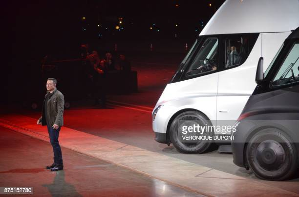 Tesla Chairman and CEO Elon Musk unveils the new 'Semi' electric Truck for buyers and journalists on November 16 2017 in Hawthorne California near...