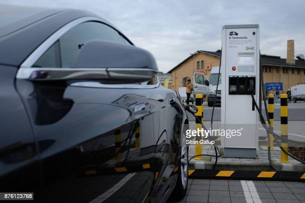 Tesla electric car charges at a charging station in the parking lot of a home furnishings store on November 18 2017 in Berlin Germany The European...