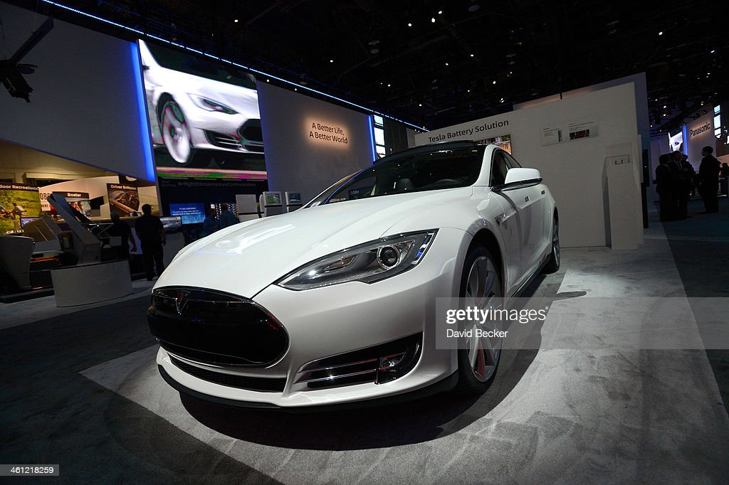 A Tesla electric car is on display at the Panasonic booth at the 2014 International CES at the Las Vegas Convention Center on January 7, 2014 in Las Vegas, Nevada. CES, the world's largest annual consumer technology trade show, runs through January 10 and is expected to feature 3,200 exhibitors showing off their latest products and services to about 150,000 attendees.