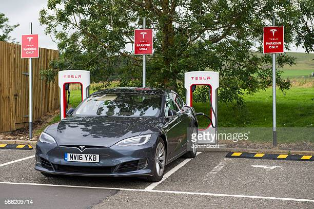 Tesla electric car plugged into a charging station