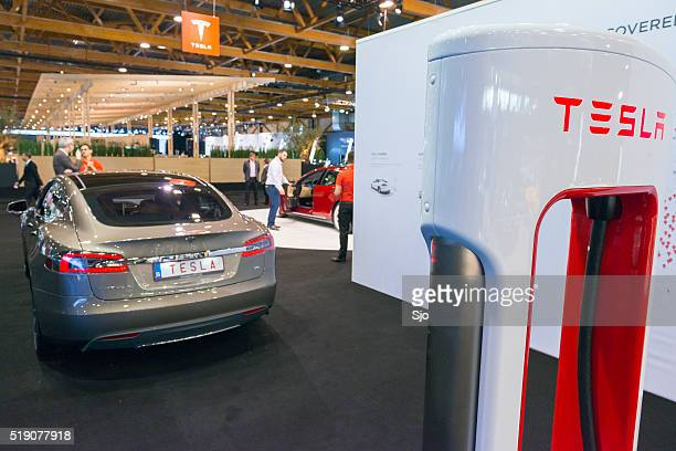 Tesla electric car supercharger charging station with Tesla Model S