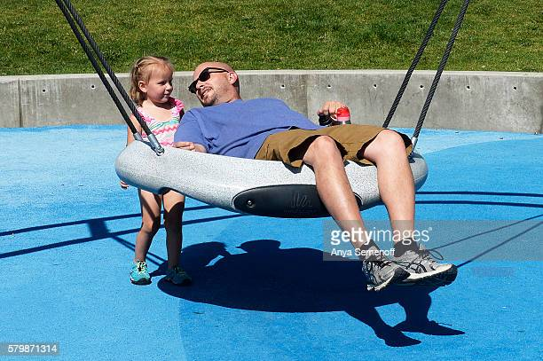 Tesla Esser pushes her father Patrick Esser on a swing at Carpenter Park on July 13 in Thornton Colorado In an effort to keep up with the growing...