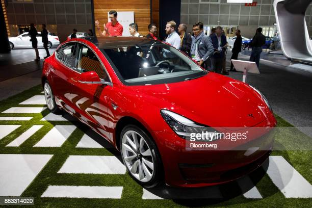 A Tesla Inc Model 3 vehicle stands on display during AutoMobility LA ahead of the Los Angeles Auto Show in Los Angeles California US on Thursday Nov...