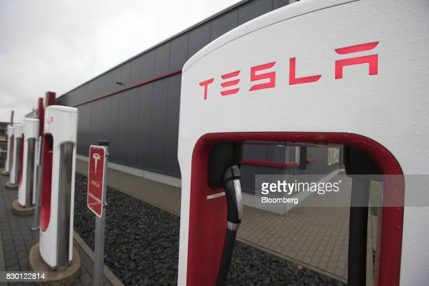 A Tesla Inc Model X electric automobile charging station stands in Frankfurt Germany on Friday Aug 11 2017 Germany's government wants carmakers to...