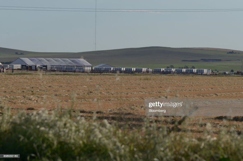 Tesla Inc. Powerpacks stand on display at the Hornsdale wind farm, operated by Neoen SAS, near Jamestown, South Australia, on Friday, Sept. 29, 2017. About half the capacity of the worlds largest lithium-ion battery project is installed at Hornsdale wind farm in South Australia, Tesla chief executive officer Elon Musksaid at an event on Sept. 29. When this is done in just a few months, it will be the largest battery installation by a factor of three in the world, Musk said. Photographer: Carla Gottgens/Bloomberg via Getty Images