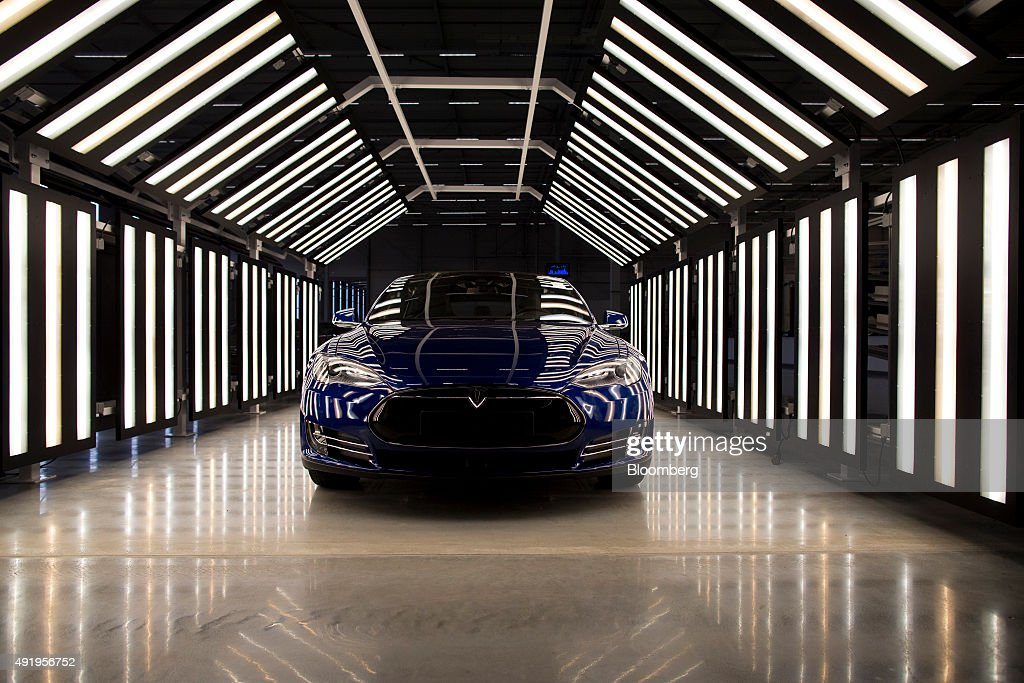 A Tesla Model S automobile stands in a light tunnel during quality control checks ahead of European shipping from the Tesla Motors Inc factory in...