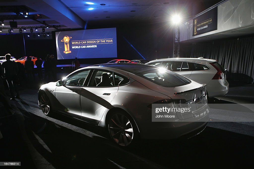 A Tesla Model S is displayed after winning the 2013 World Green Car of the Year award at the New York Auto Show on March 28, 2013 in New York City. It was chosen from an original entry list of 21 vehicles from all over the world.