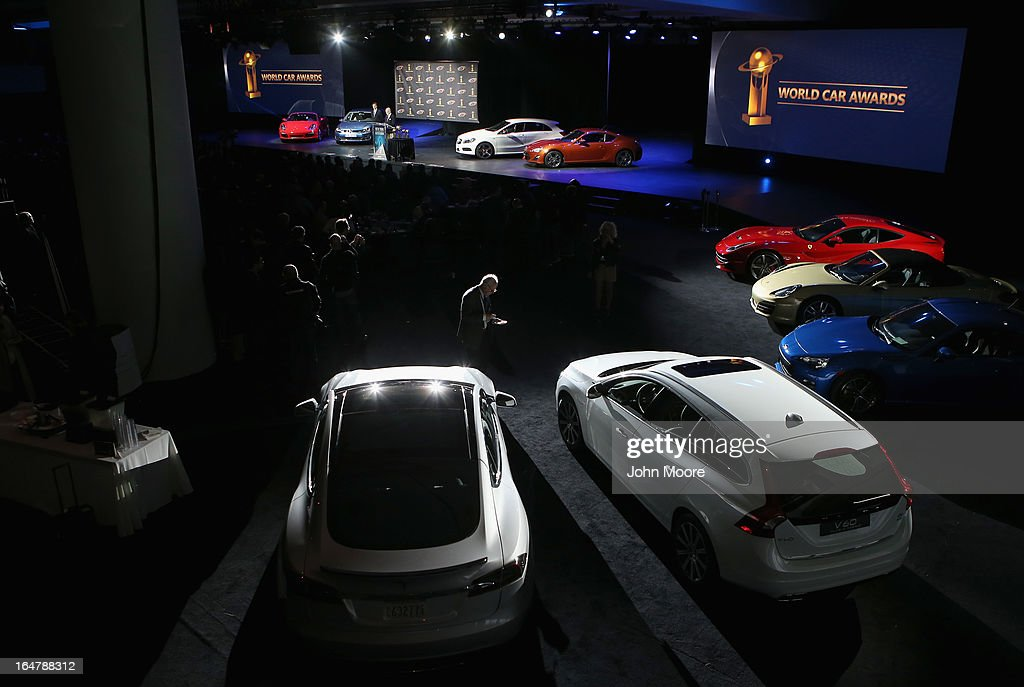 A Tesla Model S is displayed (L) with other cars after winning the 2013 World Green Car of the Year at the New York Auto Show on March 28, 2013 in New York City. It was chosen from an original entry list of 21 vehicles from all over the world.