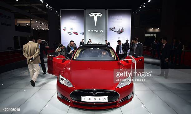 A Tesla Model S P85d car is displayed at the 16th Shanghai International Automobile Industry Exhibition in Shanghai on April 20 2015 Global car...