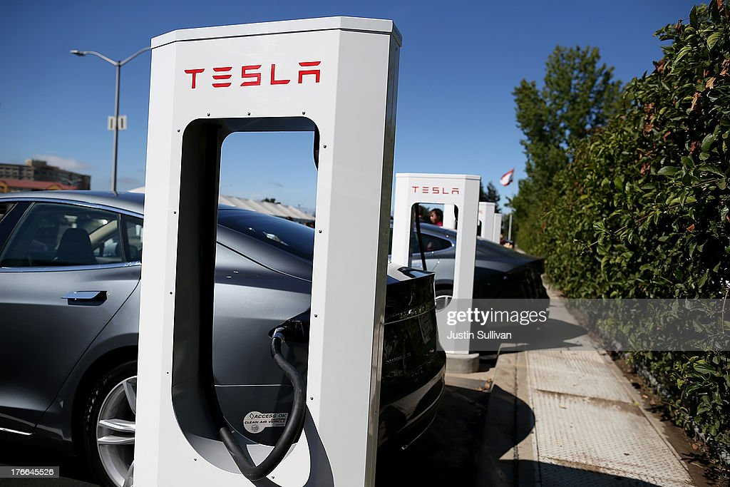 A Tesla Model S sedan is seen plugged into a new Tesla Supercharger outside of the Tesla Factory on August 16, 2013 in Fremont, California. Tesla Motors opened a new Supercharger station with four stalls for public use at their factory in Fremont, California. The Superchargers allow owners of the Tesla Model S to charge their vehicles in 20 to 30 minutes for free. There are now 18 charging stations in the U.S. with plans to open more in the near future.