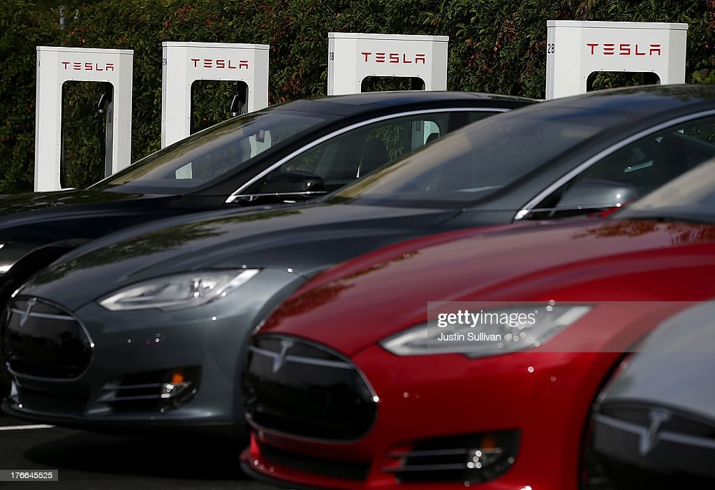 Tesla Model S sedans are seen parked in front of a row of new Tesla Superchargers outside of the Tesla Factory on August 16, 2013 in Fremont, California. Tesla Motors opened a new Supercharger station with four stalls for public use at their factory in Fremont, California. The Superchargers allow owners of the Tesla Model S to charge their vehicles in 20 to 30 minutes for free. There are now 18 charging stations in the U.S. with plans to open more in the near future.