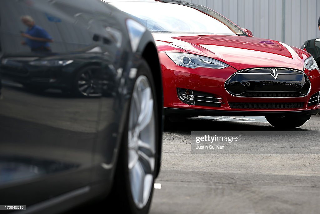 Tesla Model S sedans are seen parked in front of the Tesla Factory on August 16, 2013 in Fremont, California. Tesla Motors opened a new Supercharger station with four stalls for public use at their factory in Fremont, California. The Superchargers allow owners of the Tesla Model S to charge their vehicles in 20 to 30 minutes for free. There are now 18 charging stations in the U.S. with plans to open more in the near future.