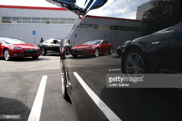 Tesla Model S sedans are seen parked in front of the Tesla Factory on August 16 2013 in Fremont California Tesla Motors opened a new Supercharger...