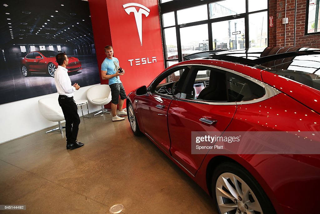 Tesla model S sits parked in a new Tesla showroom and service center in Red Hook Brooklyn on July 5 2016 in New York City The electric car company...