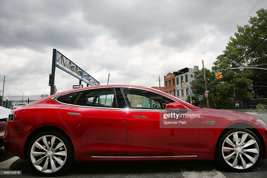 Tesla model S sits parked outside of a new Tesla showroom and service center in Red Hook Brooklyn on July 5 2016 in New York City The electric car...