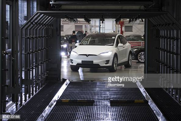 A Tesla Model X sports utility vehicle drives into a rain testing chamber during assembly for the European market at the Tesla Motors Inc factory in...
