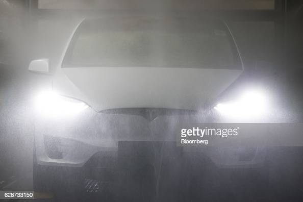 A Tesla Model X sports utility vehicle undergoes rain testing during assembly for the European market at the Tesla Motors Inc factory in Tilburg...