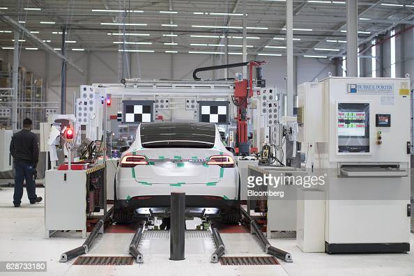 A Tesla Model X sports utility vehicle undergoes wheel alignment checks during assembly for the European market at the Tesla Motors Inc factory in...