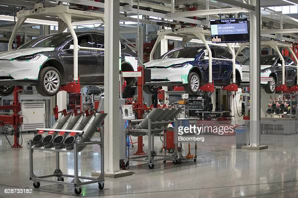 Tesla Model X sports utility vehicles sit in elevated cradles during assembly for the European market at the Tesla Motors Inc factory in Tilburg...