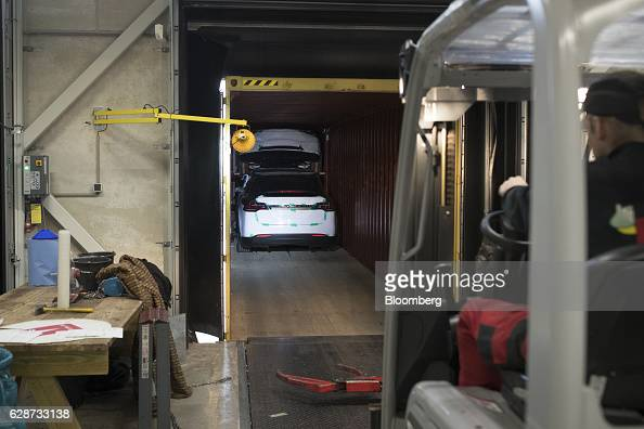 Tesla Model X sports utility vehicles sit inside a shipping container ahead of assembly for the European market at the Tesla Motors Inc factory in...