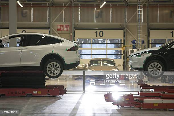 Tesla Model X sports utility vehicles stand on hydraulic platforms during assembly for the European market at the Tesla Motors Inc factory in Tilburg...