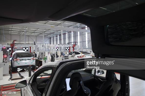 Tesla Model X sports utility vehicles undergo wheel alignment checks during assembly for the European market at the Tesla Motors Inc factory in...