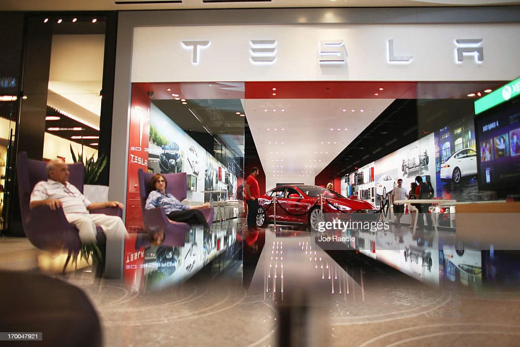 A Tesla motor company car is parked in a dealership in the Dadeland Mall on June 6, 2013 in Miami, Florida. The electric car maker is trying to make a move by selling their cars, that can cost between $62,400 and $82,400, into malls and stores.