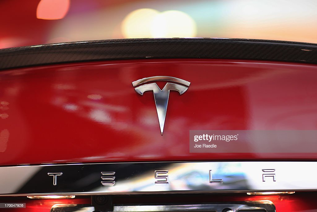 A Tesla motor company car logo sits on a car in a dealership at the Dadeland Mall on June 6, 2013 in Miami, Florida. The electric car maker is trying to make a move by selling their cars, that can cost between $62,400 and $82,400, into malls and stores.