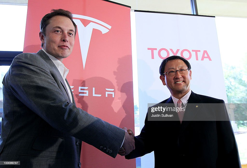 Tesla Motors CEO Elon Musk (L) and Toyota CEO Akio Toyoda shake hands after a news conference at Tesla Motors headquarters May 20, 2010 in Palo Alto, California. Electric car maker Tesla Motors annoucned a partnership with Japanese automaker Toyota to make electric cars in the United States. The cars will be manufactured at the recently shuttered NUMMI plant in Fremont, California where Toyota had pulled out after a joint partnership with General Motors had ended.