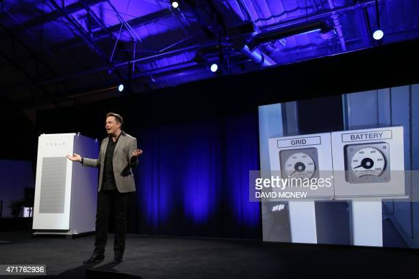 Tesla Motors CEO Elon Musk explains using graphics that his presentation is being powered solely by new Tesla batteries charged by the sun as he...