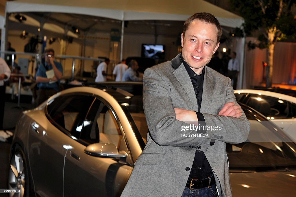 Tesla Motors Chairman and CEO Elon Musk introduces the new Tesla Model S all-electric sedan in Hawthorne, California on March 26, 2009. Musk said the state-of-the-art, five-seat sedan will be the world's first mass-produced, highway-capable electric car. The car has an anticipated base price of 57,400 US dollars but will cost less than 50,000 after a federal tax credit of 7,500 dollars. AFP PHOTO / Robyn BECK