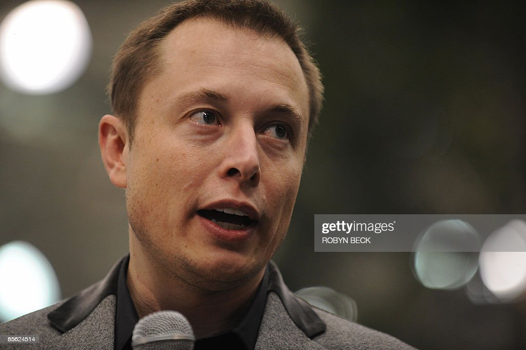 Tesla Motors Chairman and CEO Elon Musk speaks at the unveiling of the new Tesla Model S all-electric sedan, in Hawthorne, California on March 26, 2009. Musk said the state-of-the-art, five-seat sedan will be the world's first mass-produced, highway-capable electric car. The car has an anticipated base price of 57,400 US dollars but will cost less than 50,000 after a federal tax credit of 7,500 dollars. AFP PHOTO / Robyn BECK
