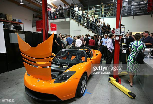 Tesla Motors employees stand near Tesla Roadster after a news conference with California governor Arnold Schwarzenegger June 30 2008 at Tesla Motors...