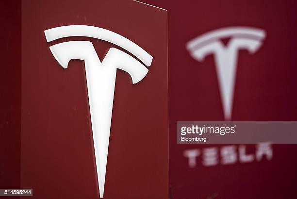 Tesla Motors Inc logo is displayed at one of the company's electric charging stations near a shopping mall in Beijing China on Wednesday March 9 2016...
