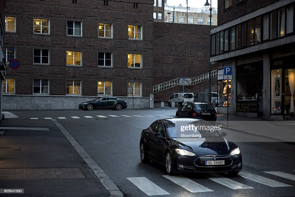 A Tesla Motors Inc. Model S electric vehicle (EV) drives past the city hall in Oslo, Norway, on Monday, Nov. 21, 2016. The International Energy Agency forecasts that global gasoline consumption has all but peaked as more efficient cars and the advent of electric vehicles from new players such as Tesla Motors Inc. halt demand growth in the next 25 years. Photographer: Fredrik Bjerknes/Bloomberg via Getty Images