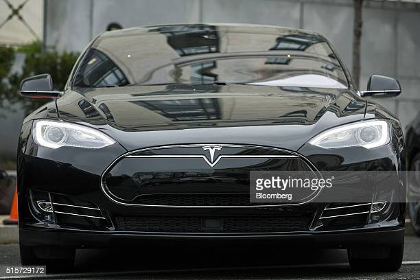 A Tesla Motors Inc Model S P90D a model with some autopilot features is displayed during an exhibition featuring several selfdriving cars outside of...